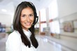 Leinwanddruck Bild - Young beautiful woman work with headphones