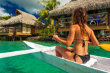 Woman Kayaking in the Ocean on Vacation at a tropical resort - 217380671