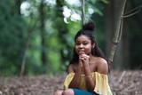 Beautiful black woman in woods - 217383815