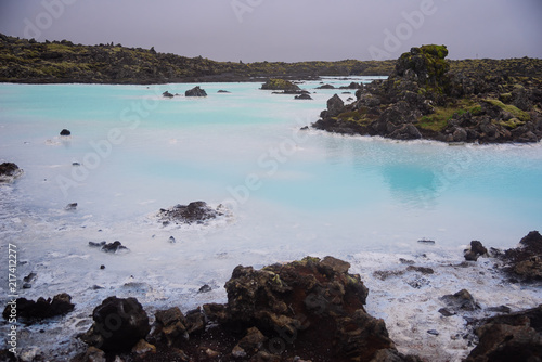 The Blue Lagoon geothermal spa and lava rocks in Iceland.