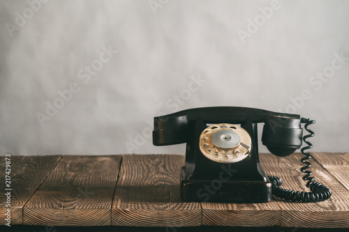 a old phone on the wood - 217429873