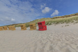 One red Beach chair at Sylt-Wenningstedt Beach / Germany - 217441426