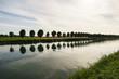 Leinwanddruck Bild - Kanal mit Bäumen