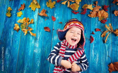 two years old boy dreaming in autumn - 217465242