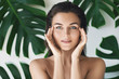 Quadro Portrait of young and beautiful woman with perfect smooth skin in tropical leaves