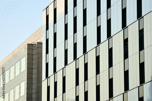 Foto Murales Urban abstract background, detail of modern glass facade, office business building.