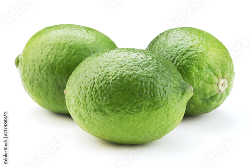 Foto Murales fresh ripe lime fruits isolated on white background