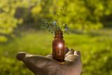 Alternative medicine - bottles & hand. - 217496059