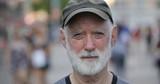 Elderly caucasian man in city face portrait - 217499072