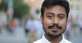Hispanic man in city face portrait - 217499095