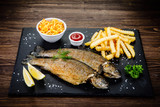 Fish dish - roast trout with vegetables - 217517091