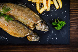 Fish dish - roast trout with vegetables - 217517212