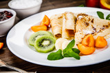 Crepes with fruits and creme  - 217518806