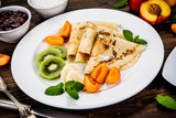 Crepes with fruits and creme  - 217518889