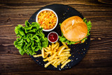 Tasty burger with chips served on stone plate  - 217519017