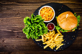 Tasty burger with chips served on stone plate  - 217519067