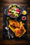 Roast chicken legs with and vegetables - 217519256