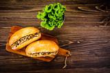 Hot dog on cutting board  - 217519476
