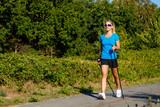Nordic walking - young woman training - 217520090