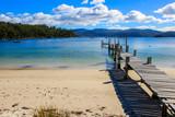 Beautiful Beach with wooden pier into the ocean, Tasmania, Australia