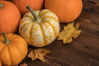 Leinwanddruck Bild - Pumpkins on wooden background