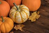 Pumpkins on wooden background - 217540090