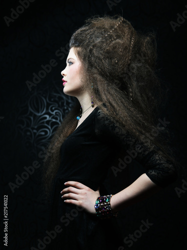 Foto Murales portrait of beautiful woman in black dress with fashion hairstyle. Fashion and beauty concept.