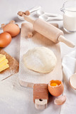 Dough preparation recipe for bread, pizza, pasta, cookies or pie ingridients, food flat lay on kitchen table background. Working with butter, milk, yeast, flour, eggs, sugar pastry or bakery cooking.