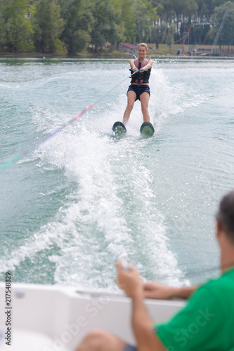 Foto Murales happy young girl learning on a water ski