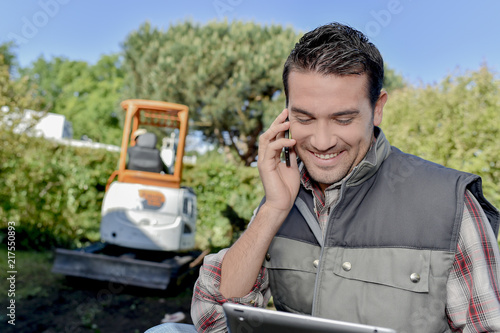 Foreman using a mobile phone