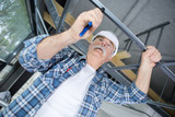senior worker installing scaffolding at construction site - 217555261