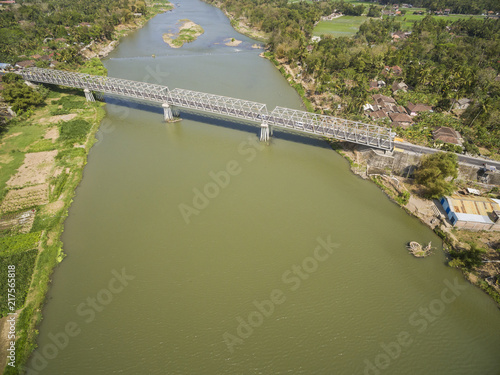 Fototapeta Aerial photo of long bridge in Kretek village, Yogyakarta, Indonesia. Taken 13 August 2018