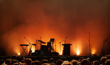 empty concert stage on music festival, instruments silhouettes, microphones drums guitars and crowd of people - 217568861
