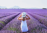 dream and inspiration, summer happy woman in romantic white dress enjoying nature in lavender flowers fields - 217568892