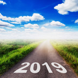 Empty asphalt road and New year 2019 concept. Driving on an empty road to Goals 2019. - 217569493