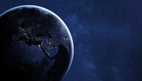 planet Earth by night in starry sky, view from space, original image furnished by NASA - 217569668