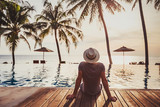 tourist in luxury beach hotel near luxurious swimming pool at sunset, tropical exotic holidays vacation, tourism and travel - 217569673