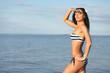 tanned girl with bikini on sea background