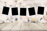 Empty wood table and instant photo hanging on blur image background of people display montage for product. - 217570847