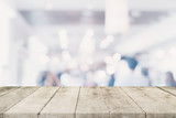 Empty wooden table with blurred abstract people on cafe on restaurant background. - 217570864