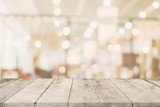Empty wooden table with blurred abstract people on cafe on restaurant background. - 217570888