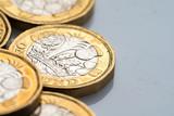 New British one pound coin in studio - 217572282