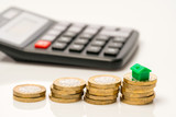 Housing estate concept with coins in studio - 217573268