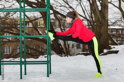 Foto Murales Woman urban exercising outside during winter