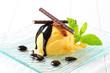 Quadro Ice cream with chocolate sauce and mint sticks