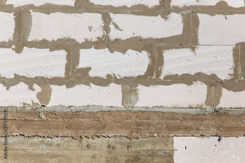 Foto Spatwand Betonbehang Bricks made of concrete blocks as a background
