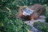 Offroad car on a moody road. - 217591645