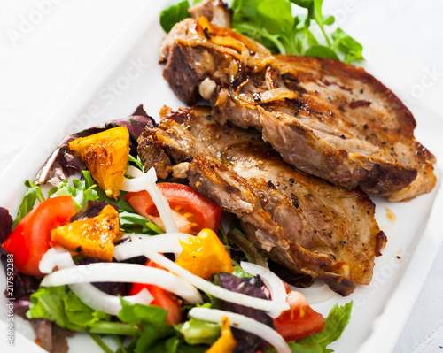 Grilled pork chop with salad - 217592288
