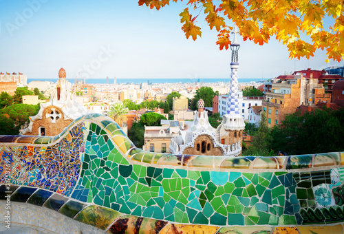 fototapeta na ścianę Gaudi bench and cityscape of Barcelona from park Guell, famous view of Barcelona, Spain at fall