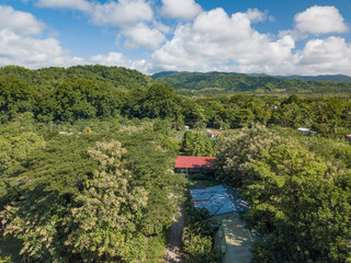 Rural Farms and the green lush jungle around Paquera Costa Rica captured via Drone